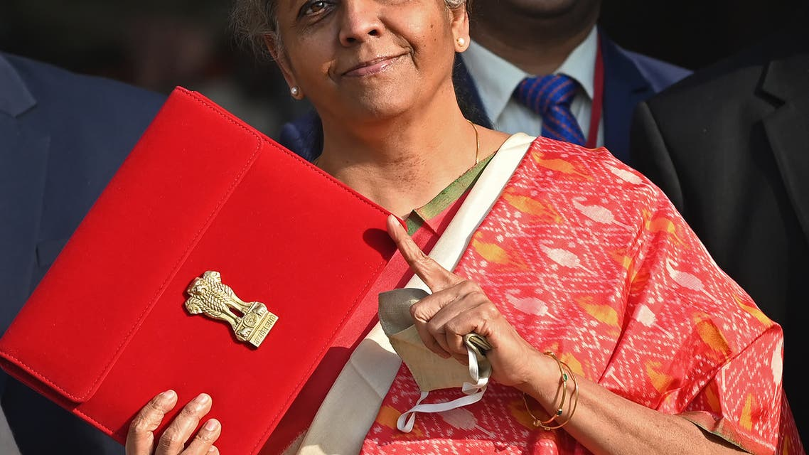India's Finance Minister Nirmala Sitharaman gestures as she leaves the Finance Ministry to present the annual budget in parliament in New Delhi on February 1, 2021. (AFP)
