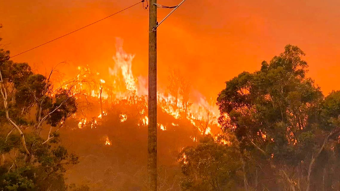 In this photo provided by Department of Fire and Emergency Services, fire burns on a hill at Wooroloo, near Perth, Australia, Monday, Feb. 1, 2021. (AP)