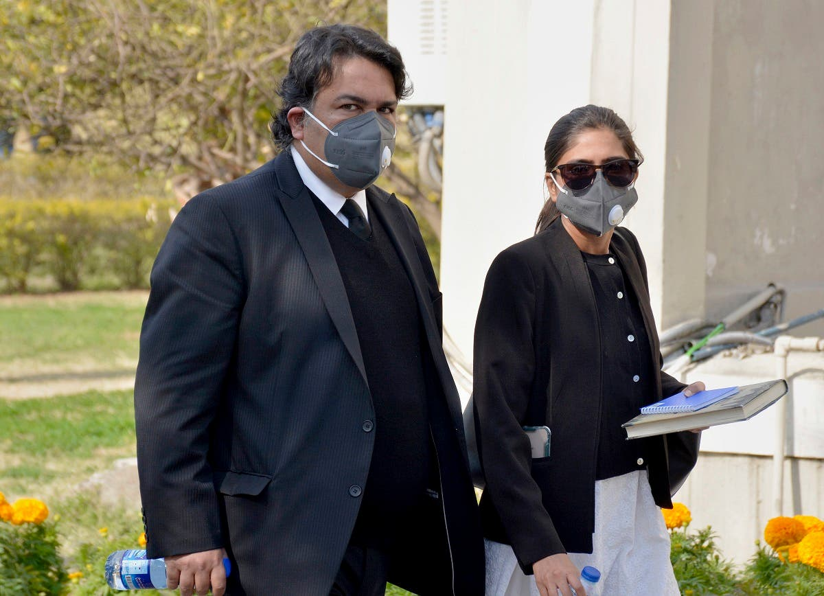 Faisal Siddiqi, left, a lawyer for the family of Daniel Pearl, an American reporter who was kidnapped and killed in Pakistan, arrives with his assistant at the Supreme Court for an appeal hearing in the Daniel Pearl case, in Islamabad, Pakistan. (AP)