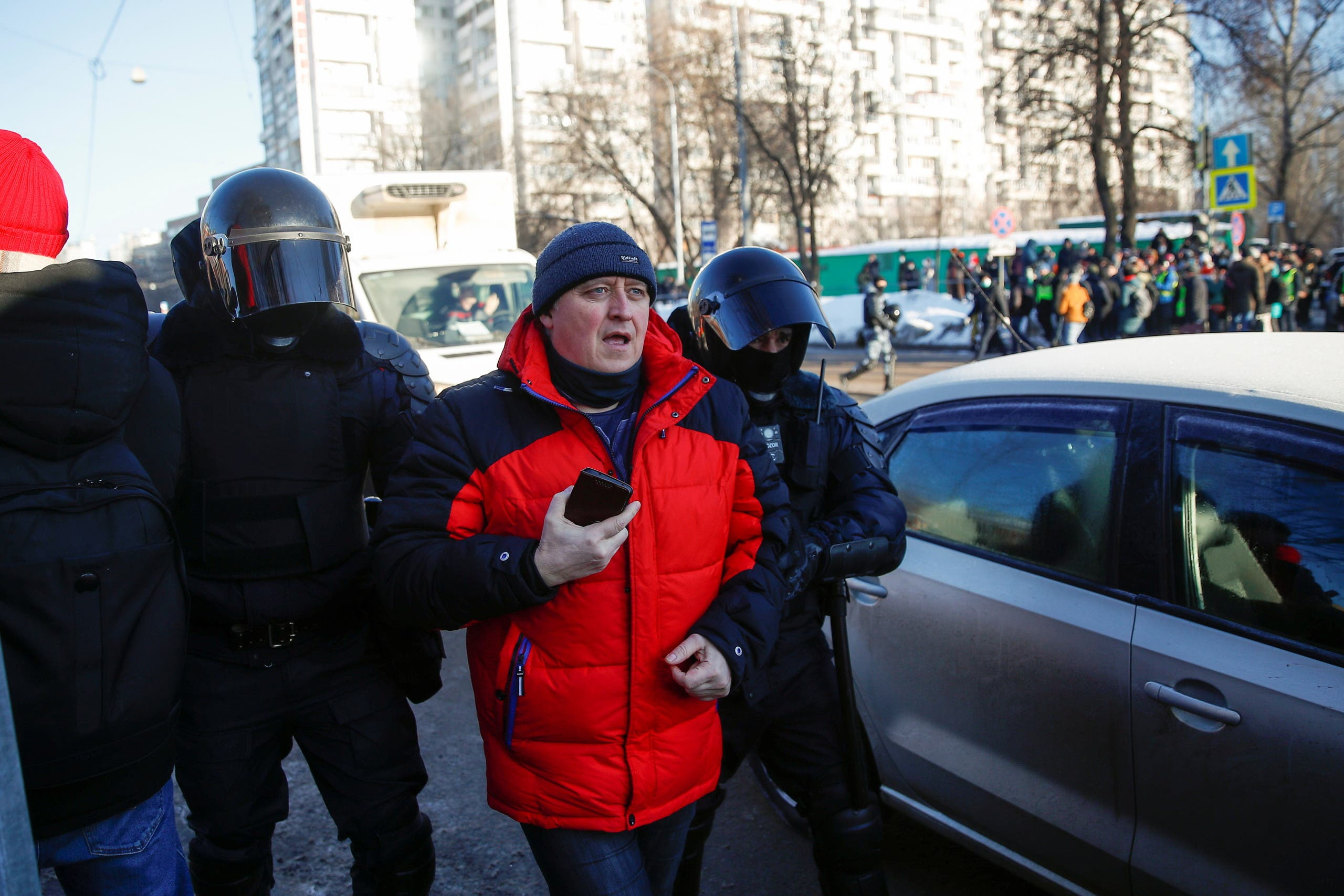 Law enforcement officers detain a man near a court building during a hearing to consider the case of Russian opposition leader Alexei Navalny, who is accused of flouting the terms of a suspended sentence for embezzlement, in Moscow, Russia February 2, 2021. (Reuters)