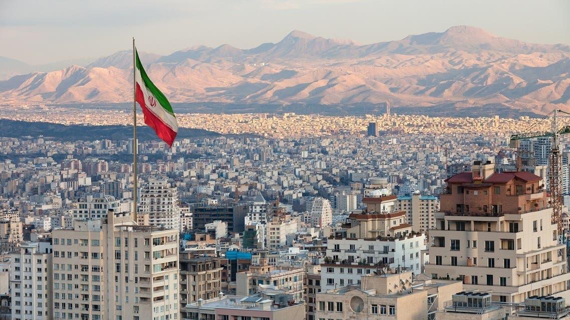 An Iranian flag waves above Tehran. (iStock)