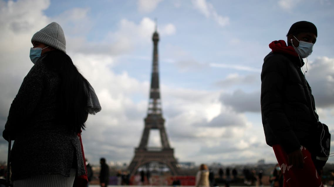 People, wearing protective face masks, walk at Trocadero square near the Eiffel Tower in Paris amid the coronavirus disease (COVID-19) outbreak in France, January 22, 2021. (Reuters)