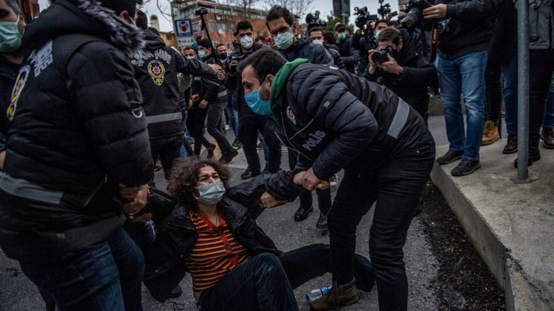 Turkish police detain a woman during a demonstration outside the Bogazici University in Istanbul, on February 1, 2021. (AFP)