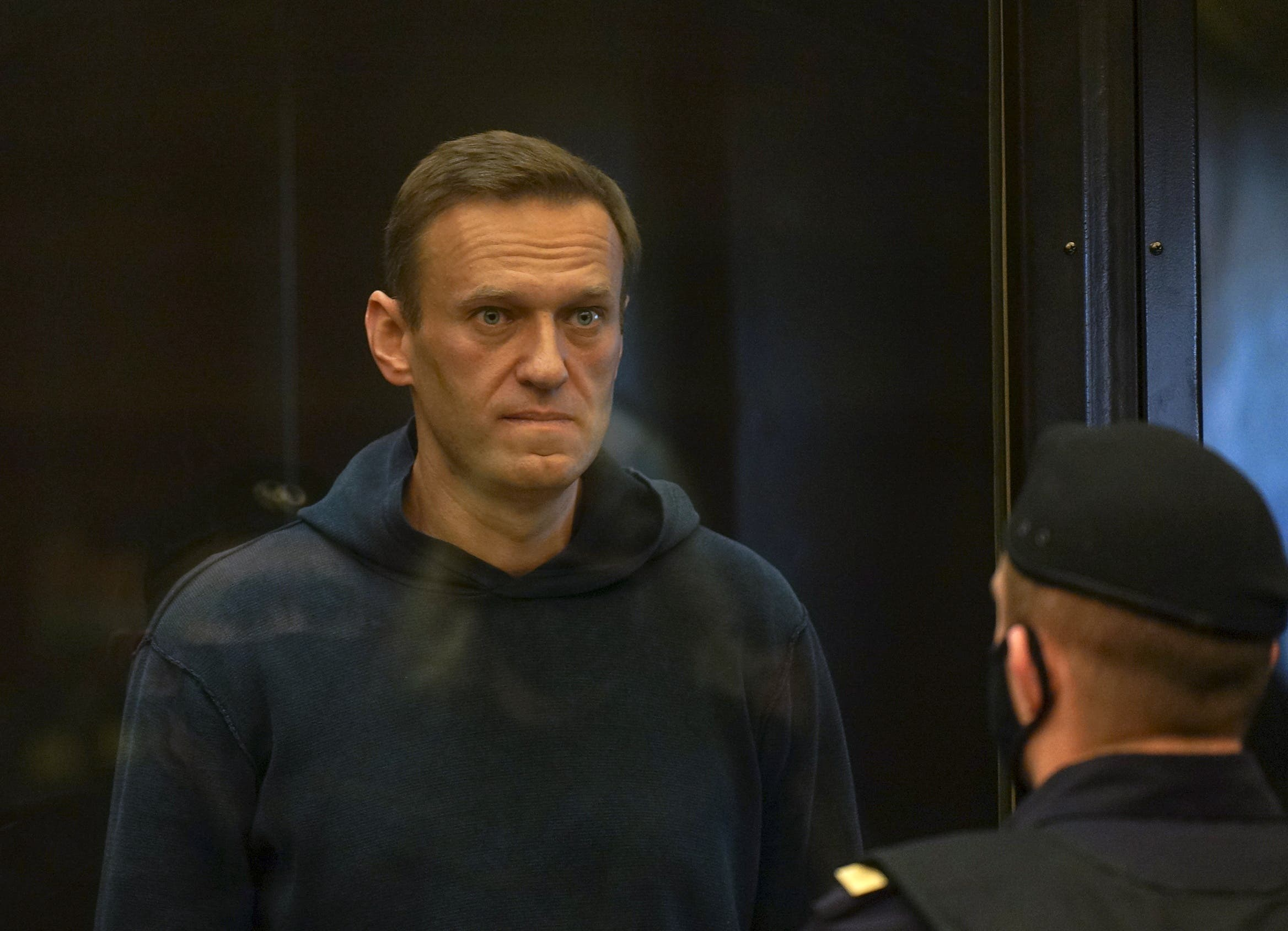 Russian opposition leader Alexei Navalny accused of flouting the terms of a suspended sentence for embezzlement attends a court hearing in Moscow, Russia February 2, 2021. (Press service of Moscow City Court/Handout via Reuters)