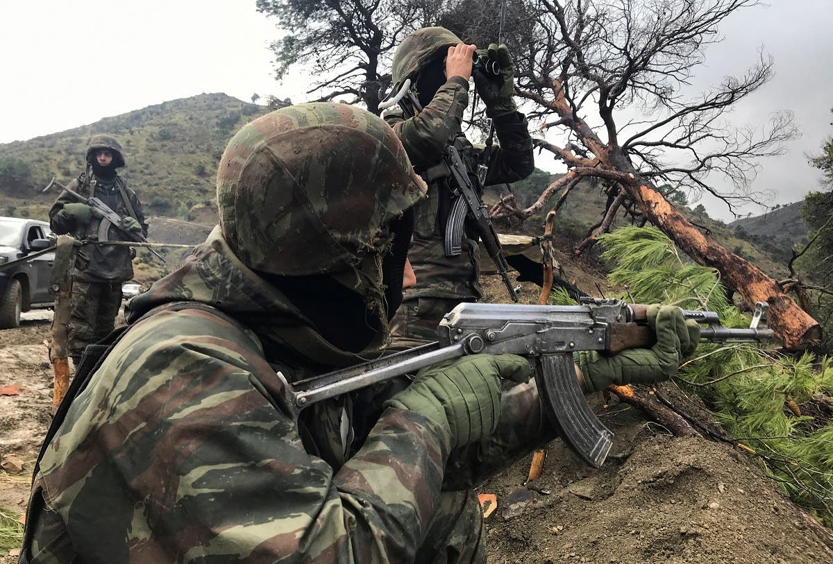 Algerian soldiers take positions during an operation against extremist militants, in the Ain Defla mountains, west of the capital Algiers, Algeria January 26, 2021. (Reuters/Abdelaziz Boumzar)