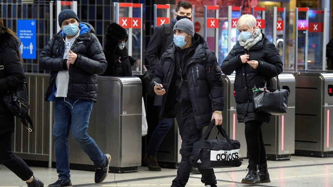 Passengers wearing protective masks enter an underground railway station, amid the spread of the coronavirus , in Stockholm, Sweden. (Reuters)