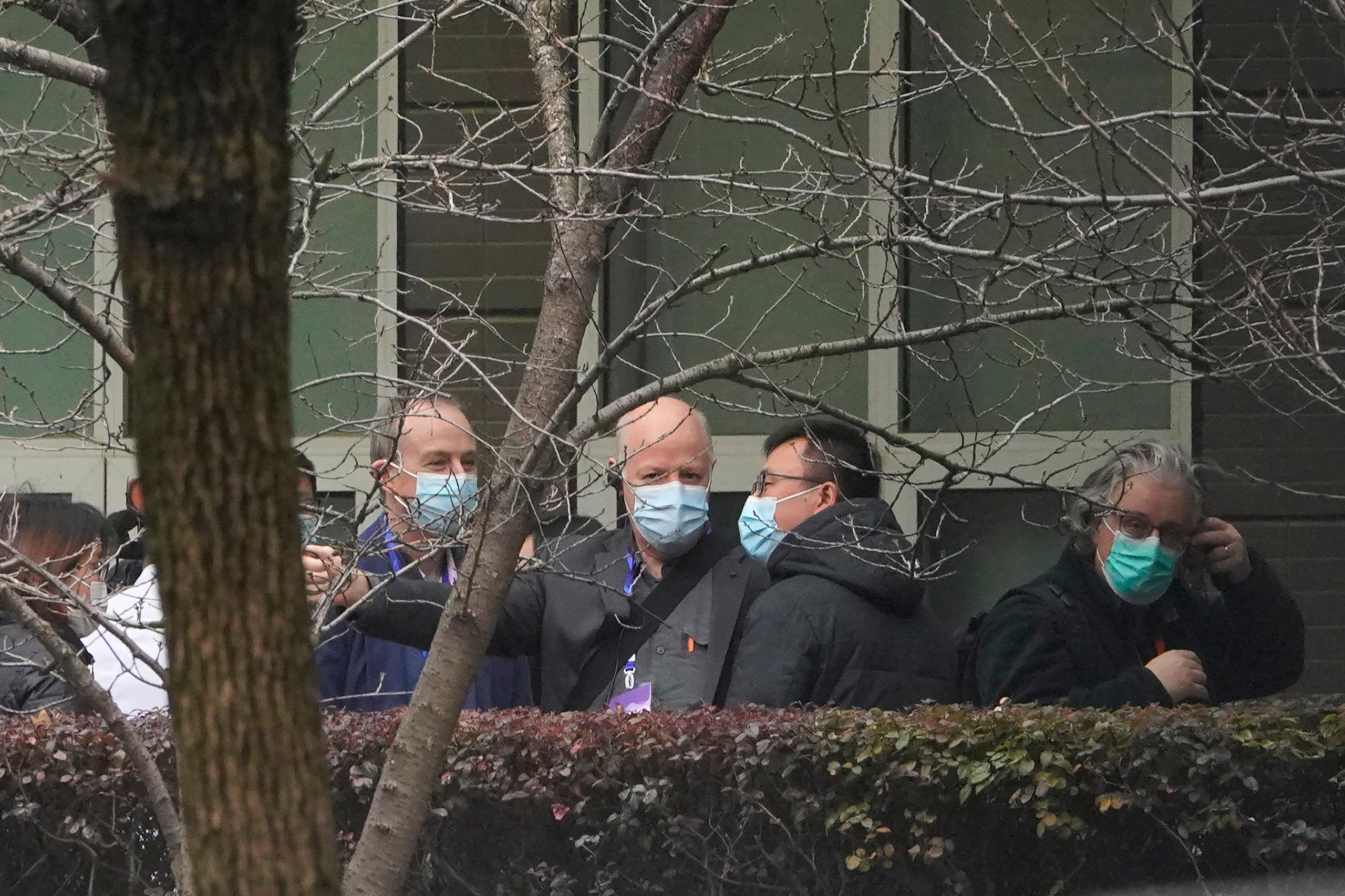 Peter Daszak of the World Health Organization team, center, chats after arriving at the Hubei Animal Disease Control and Prevention Center in Wuhan, China, Tuesday, Feb. 2, 2021. (AP)