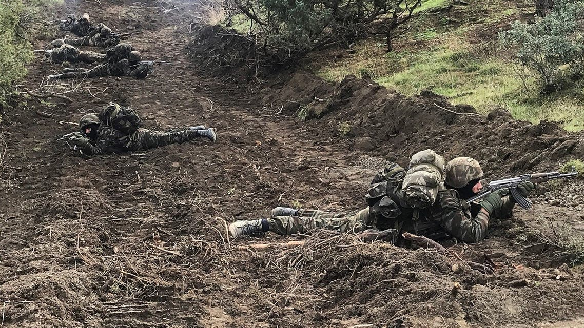Algerian soldiers take positions during an operation against extremist militants, in the Ain Defla mountains, west of the capital Algiers, Algeria January 27, 2021. (Reuters/Abdelaziz Boumzar)