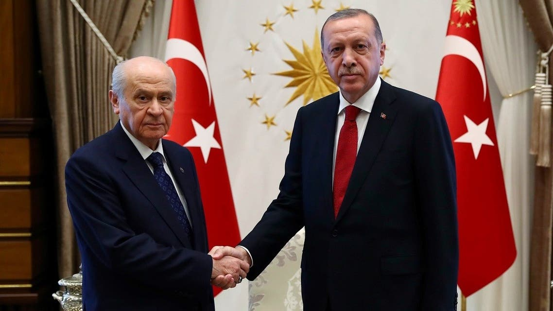 This handout photo released by the Turkish Presidential Press Service shows Devlet Bahceli (L) with Turkey's President Recep Tayyip Erdogan (R) before a meeting at the presidential palace in Ankara, on June 27, 2018. (Kayhan OZER/AFP)