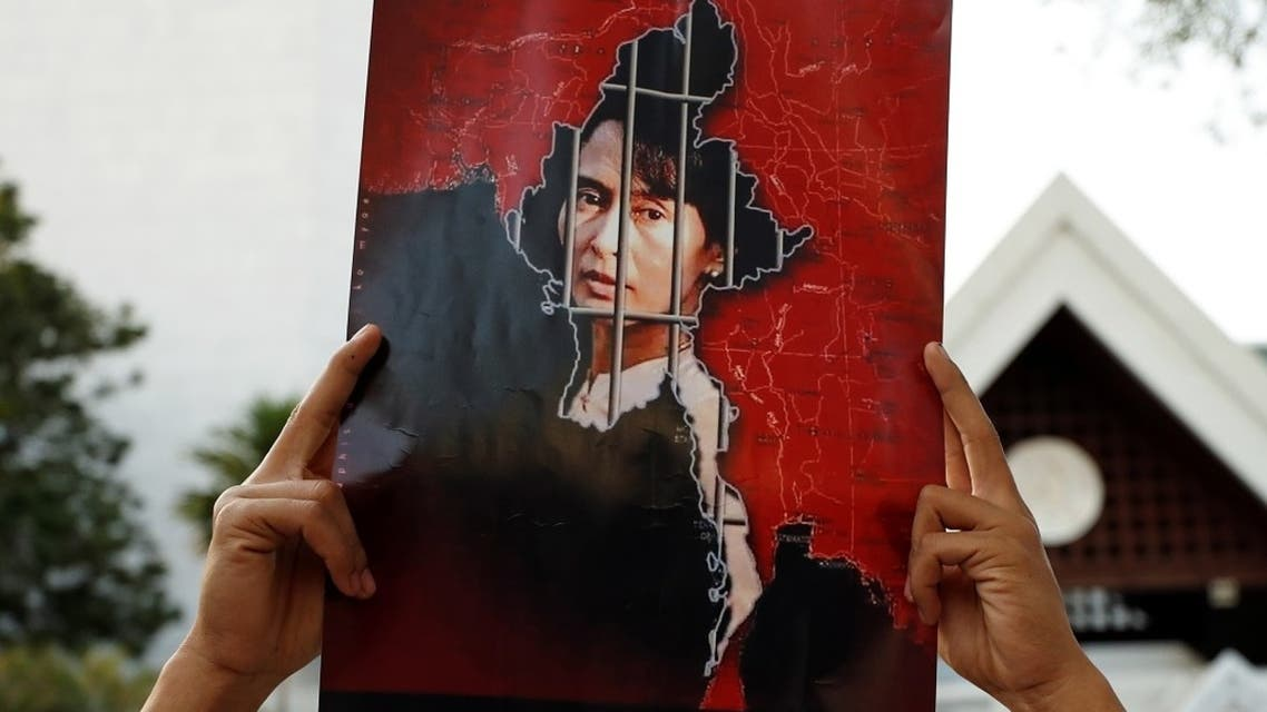 A Myanmar citizen holds up a picture of leader Aung San Suu Kyi after the military seized power in a coup in Myanmar, outside United Nations venue in Bangkok, Thailand February 2, 2021. (Reuters)