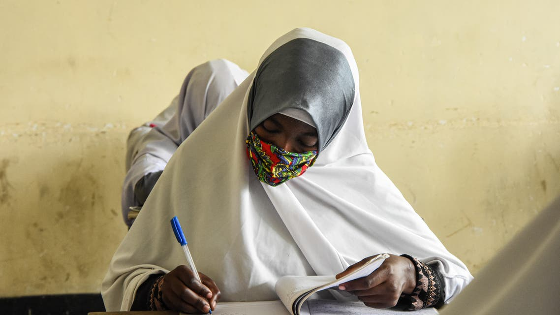 Students of Al-Haramain secondary school attend a class on their first day of re-opened school in Dar es Salaam, Tanzania, on June 1, 2020. (AFP)
