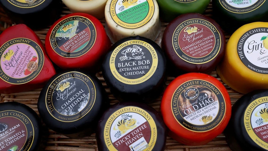 Individually wrapped cheeses from the Cheshire Cheese company are displayed in a tray at Hartington Creamery near Matlock, Britain, on January 28, 2021. (Reuters)