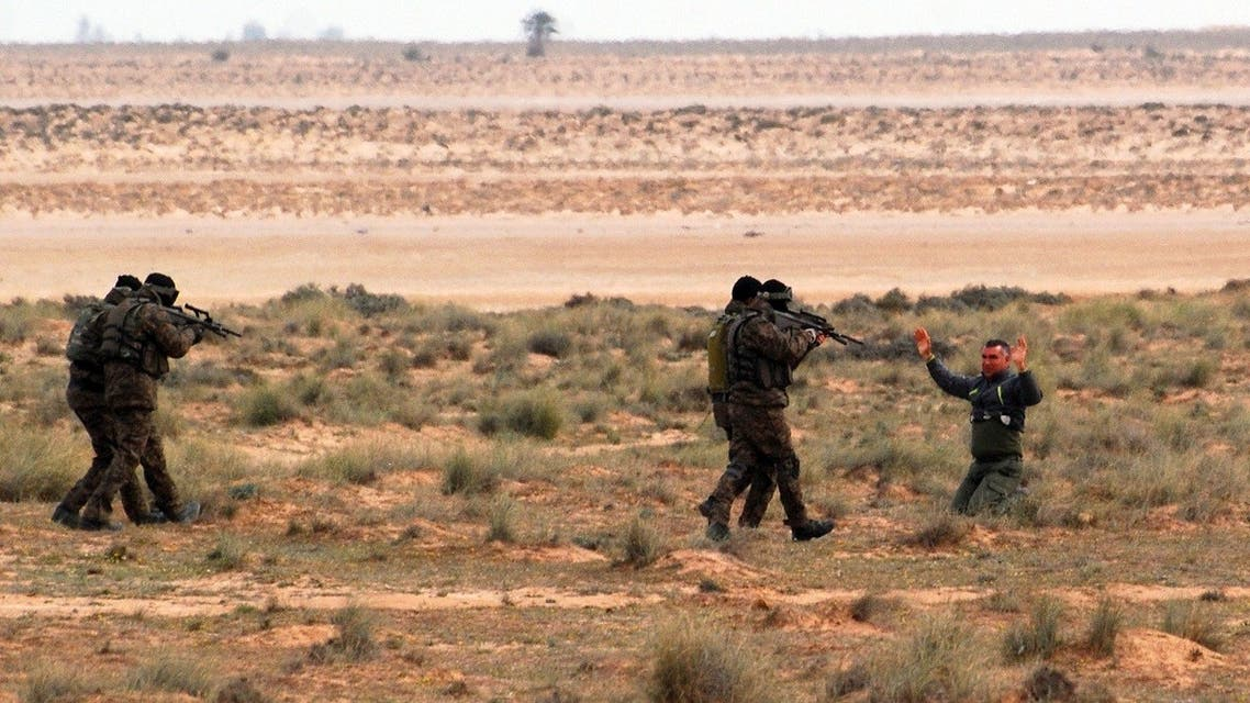 File photo of Tunisian soldiers act out an arrest during a presentation of the anti-extremist fence, in near Ben Guerdane, eastern Tunisia, close to the border with Libya. (AP)