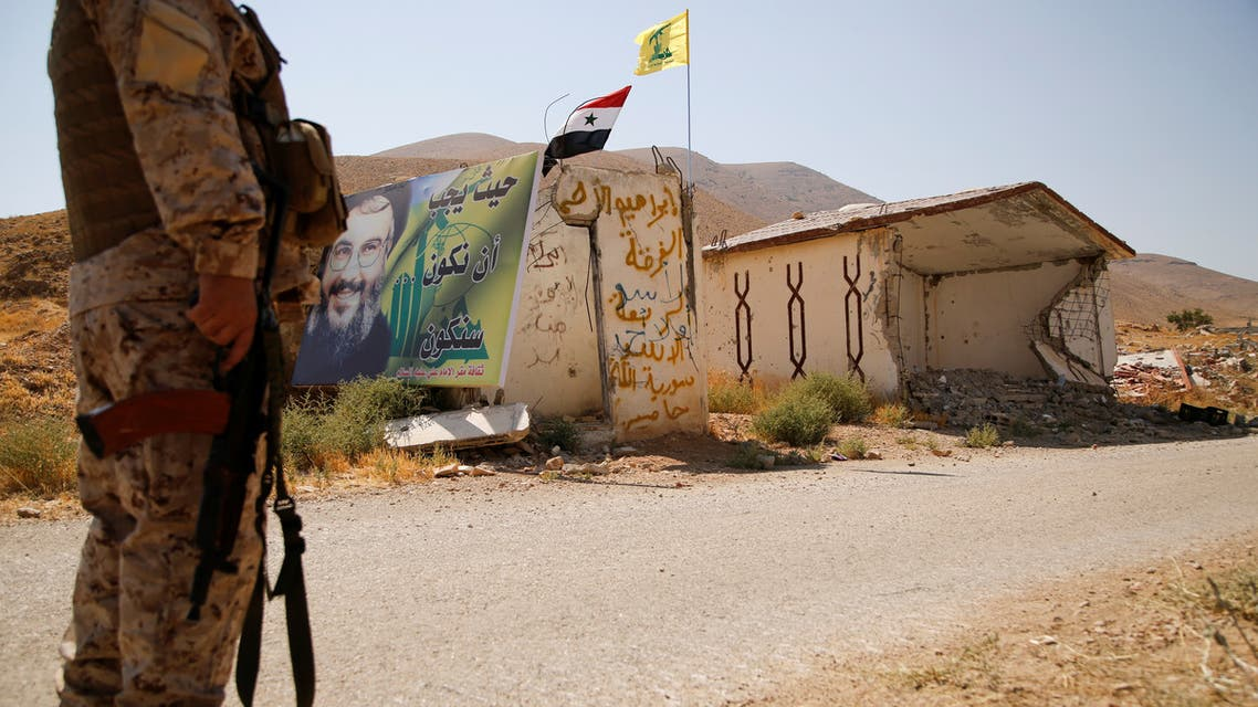 A Hezbollah fighter stands as he holds his weapon in Western Qalamoun, Syria August 23, 2017. REUTERS/Omar Sanadiki