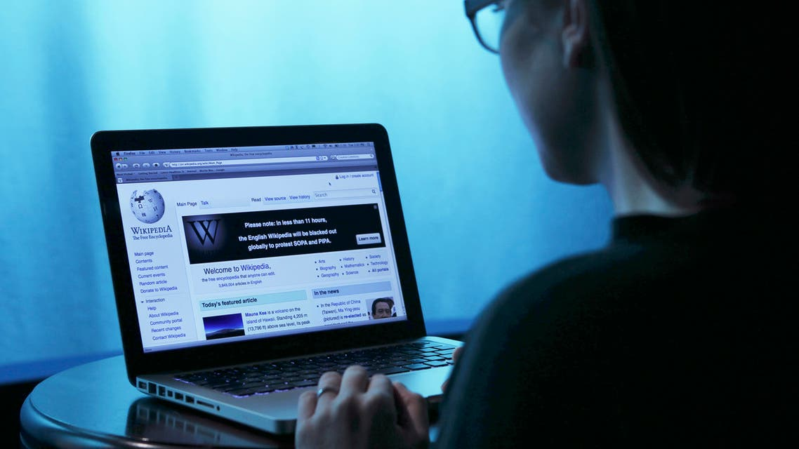 Wikipedia webpage in use on a laptop computer is seen in this photo illustration taken in Washington, January 17, 2012. Wikipedia, the popular community-edited online encyclopedia, will black out its English-language site for 24 hours to seek support against proposed U.S. anti-piracy legislation that Wikipedia founder Jimmy Wales said threatens the future of the Internet. REUTERS/Gary Cameron (UNITED STATES - Tags: SCIENCE TECHNOLOGY CRIME LAW)