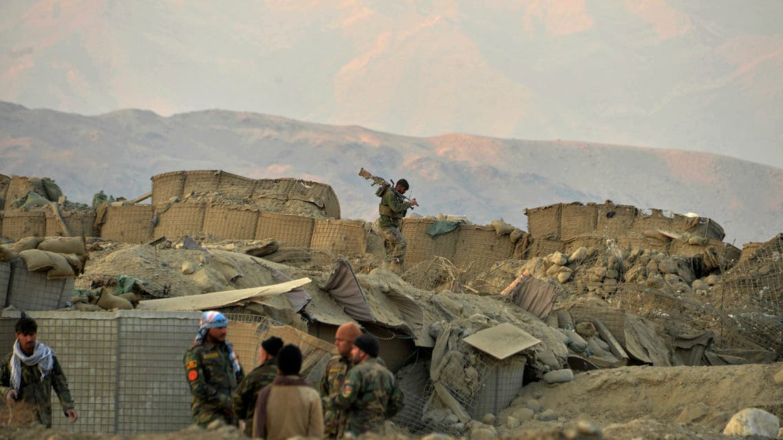 Afghan security force personnel arrive at the site of a car bomb attack in Sherzad district of Nangarhar Province on January 30, 2021. (AFP)