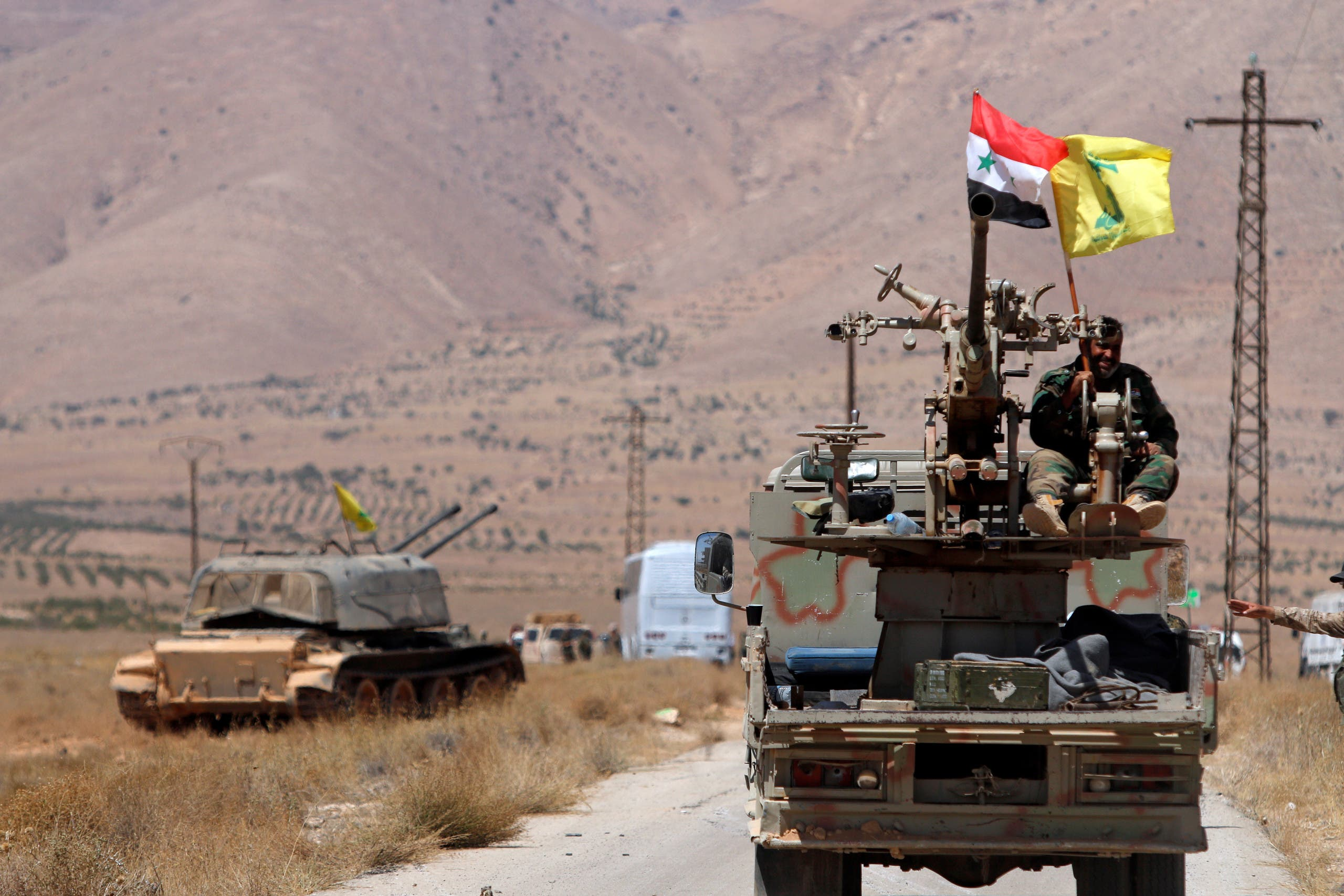 Hezbollah and Syrian flags flutter on a military vehicle in Western Qalamoun, Syria August 28, 2017. (File photo: Reuters)