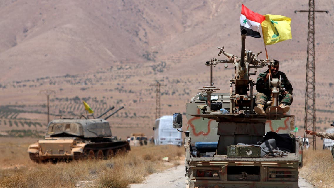 Hezbollah and Syrian flags flutter on a military vehicle in Western Qalamoun, Syria. (File Photo: Reuters)