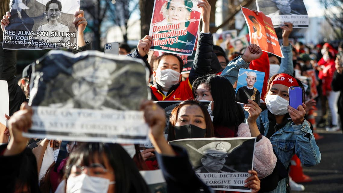 Protesters from Myanmar residing in Japan hold portraits of leader Aung San Suu Kyi and Myanmar's President Win Myint at a rally against Myanmar's military after it seized power from a democratically elected civilian government and arrested the duo, outside Foreign Ministry in Tokyo, Japan February 3, 2021. REUTERS/Issei Kato