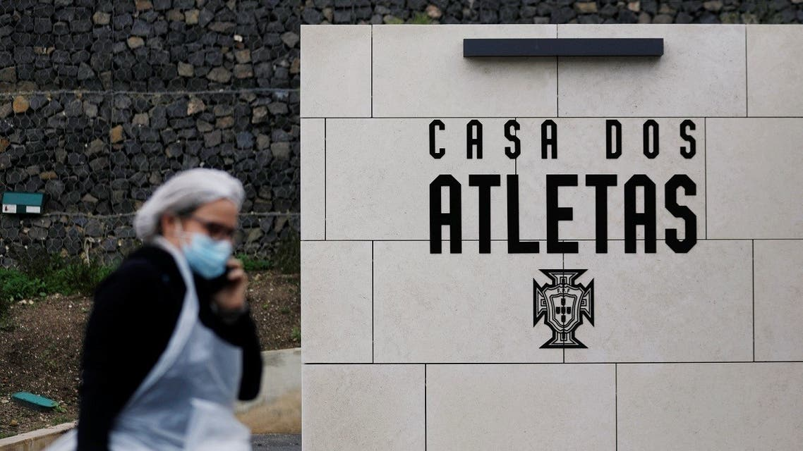 A worker wearing protective equipment walks in Cidade do Futebol, Portugal's soccer squad's training ground hotel facility, now receiving COVID-19 patients in Lisbon, Portugal on February 2, 2021. (Reuters)