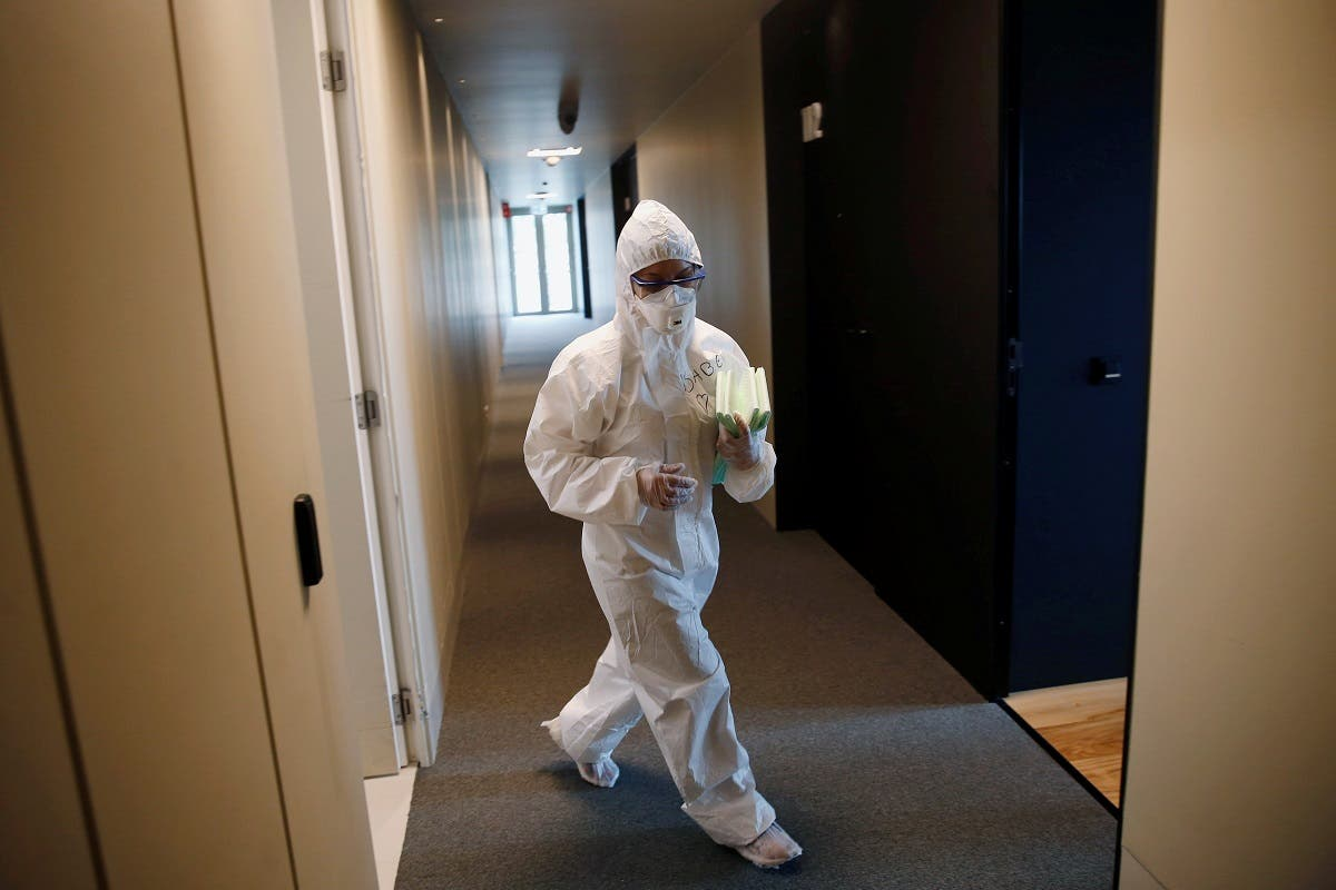 A health worker wearing personal protective equipment (PPE) walks in Cidade do Futebol, Portugal's soccer squad's training ground hotel facility, in Lisbon, Portugal, on February 2, 2021. (Reuters)