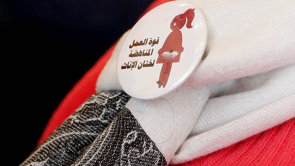 A badge reads The power of labor aginst FGM is seen on a volunteer during a conference on International Day of Zero Tolerance for Female Genital Mutilation (FGM) in Cairo. (Reuters)