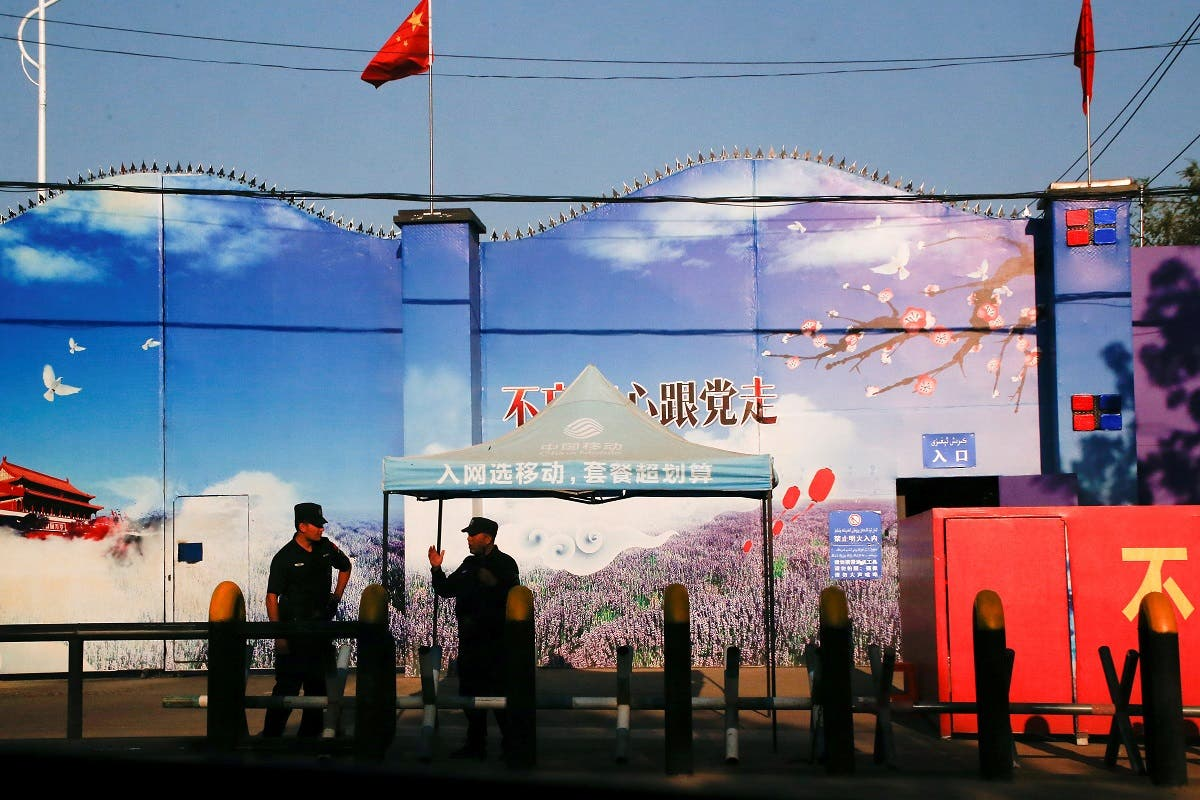 Security guards stand at the gates of what is officially known as a vocational skills education center in Huocheng County in Xinjiang Uighur Autonomous Region, China. (File photo: Reuters)