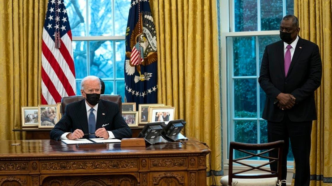 Secretary of Defense Lloyd Austin next to President Joe Biden in the Oval Office, Jan. 25, 2021. (AP)