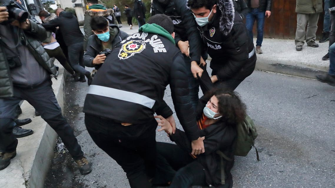 A woman scuffles with police officers as she waits in front of the Bogazici University in solidarity with students inside the campus who are protesting against the new rector and the arrest of two students, in Istanbul, Turkey February 1, 2021. REUTERS/Murad Sezer
