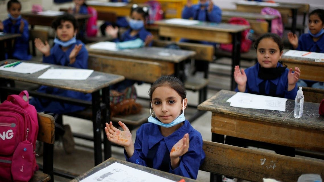 Refugee students gesture on the first day of the new school year at one of the UNRWA schools, in Amman, Jordan Sept. 1, 2020. (Reuters)