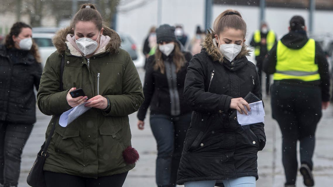 Cross-border workers go to a testing point to get a Covid-19 antigen test at the Czech-German border in Horni Folmava (Obervollmau) near Ceska Kubice, Czech Republic, on January 25, 2021. (AFP)