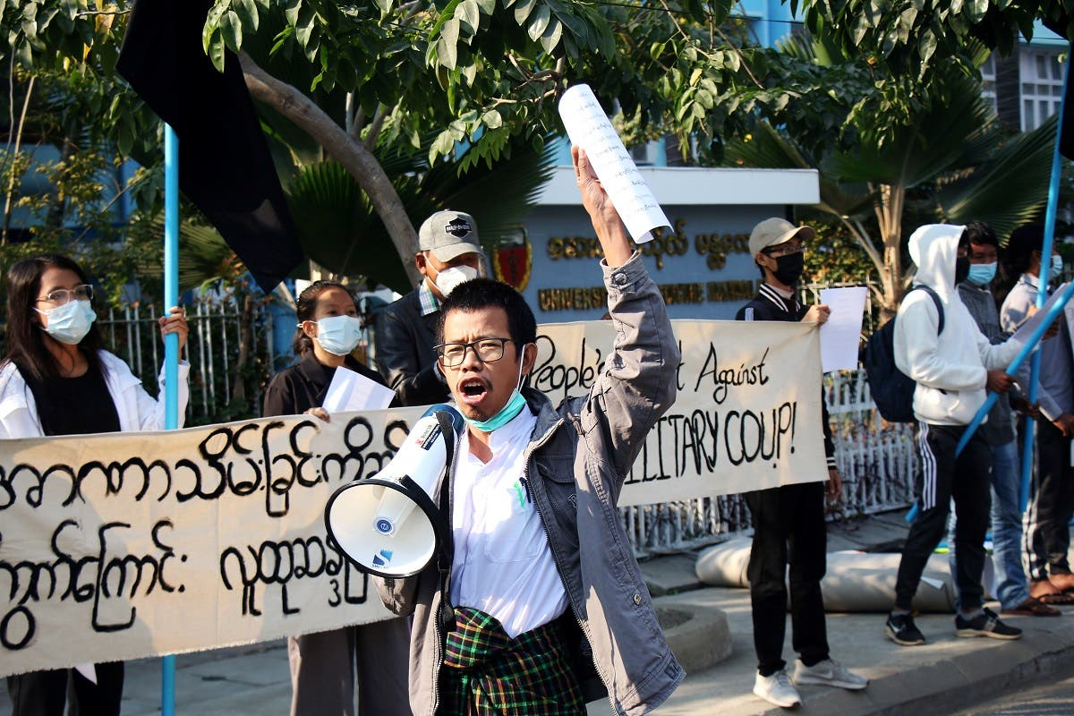 People protest on the street against the military after Monday's coup, outside the Mandalay Medical University in Mandalay, Myanmar, on February 4, 2021. (Reuters)