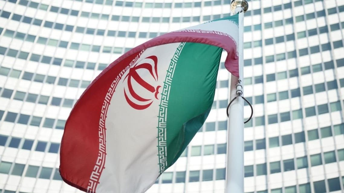 An Iranian flag waves in a wind outside the Vienna International Centre hosting the United Nations (UN) headquarters and the International Atomic Energy Agency (IAEA), on July 3, 2014. (AFP)
