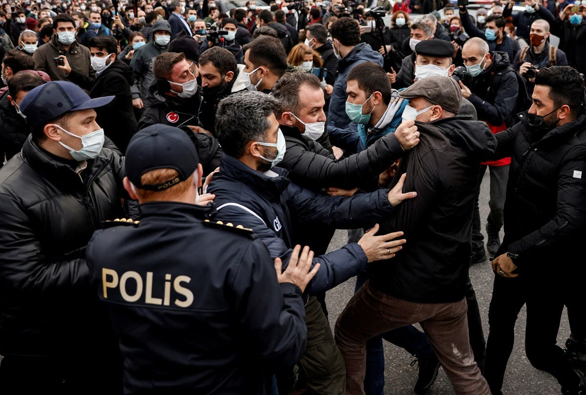 A plainclothes police officer grabs Ahmet Sik, independent member of Turkish Parliament, during a protest in Istanbul, on Feb. 2, 2021. (Reuters)
