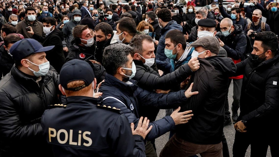 A plainclothes police officer grabs Ahmet Sik, independent member of Turkish Parliament, by the jacket during a gathering in solidarity with Bogazici University students who are protesting against the appointment of Melih Bulu as new rector of the university, in Istanbul, Turkey, on February 2, 2021. (Reuters)