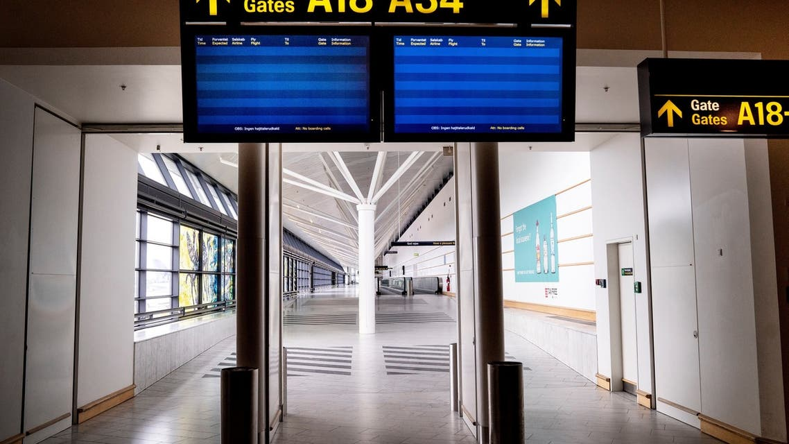 A picture taken on May 15, 2020 shows empty screens at almost empty Copenhagen Airport, amid the new coronavirus pandemic. (AFP)