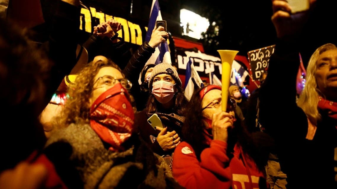 People protest against Israeli Prime Minister Benjamin Netanyahu's alleged corruption while Israel is under a lockdown as part of the coronavirus restrictions in Jerusalem, on January 30, 2021. (Reuters)