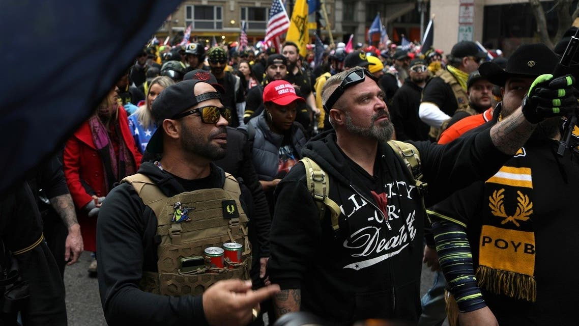 Proud Boys members Enrique Tarrio, left, and Joe Biggs march during a December 12, 2020 protest in Washington, D.C. (Reuters)