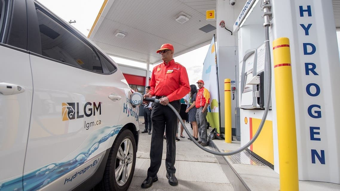 A Shell worker refuels a vehicle at the first retail hydrogen fuelling station in Vancouver, Canada. (Reuters)