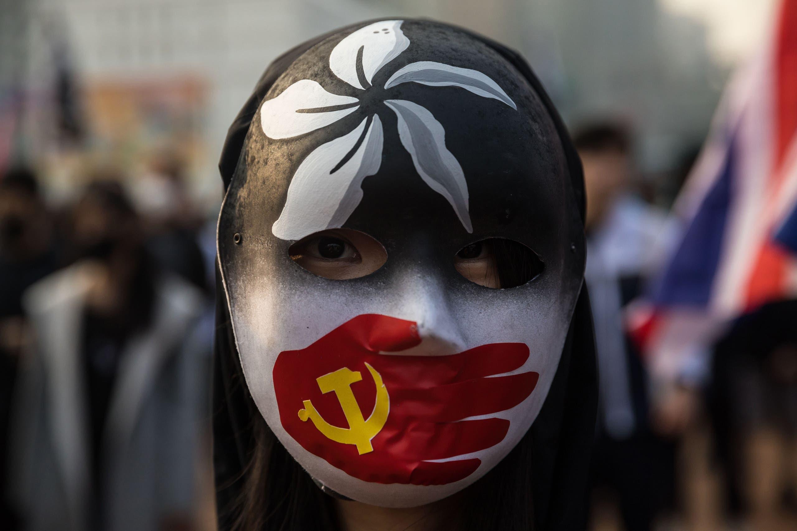 محتجون يتضامنون مع الإيغور (فرانس برس)