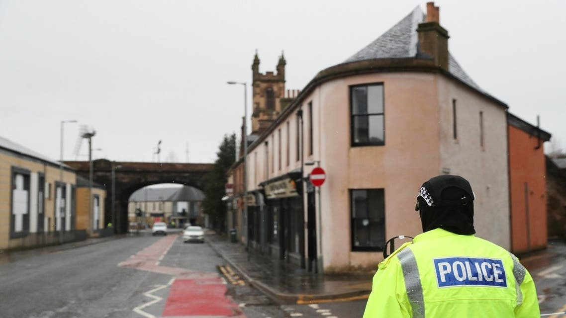 A police officer stands guard on Portland Street, following three major incidents reported in Kilmarnock, Scotland, Britain, on February 5, 2021. (Reuters)