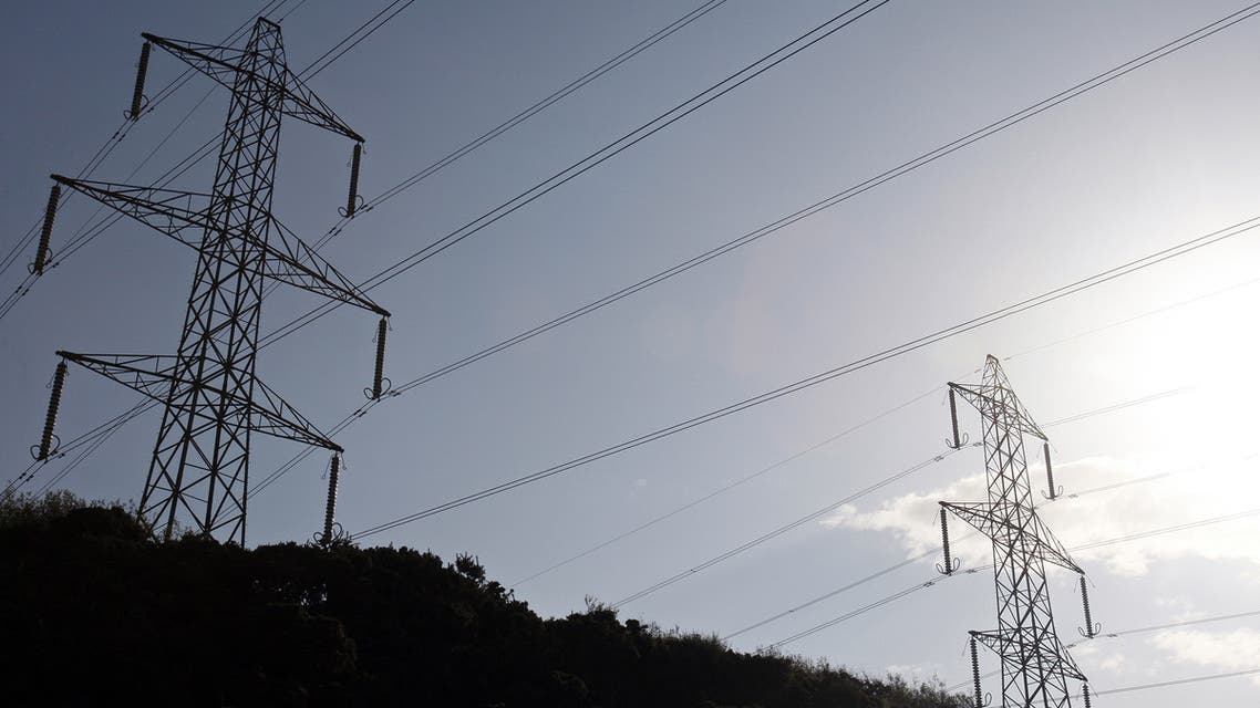 Power lines near British Energy's Heysham Nuclear Power Station are pictured in north-west England. (AFP)