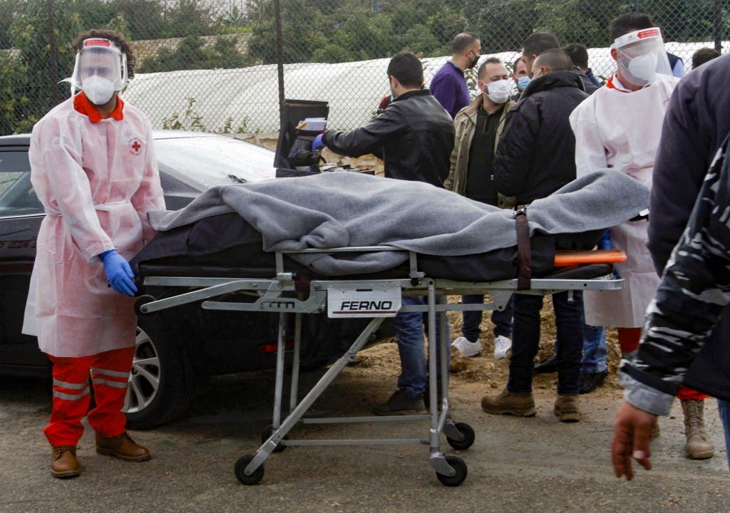 Medics evacuate the body of prominent Lebanese activist and intellectual Lokman Slim from the spot where he was found dead in his car near southern Lebanese city of Saida, on February 4, 2021. (File photo: AFP)