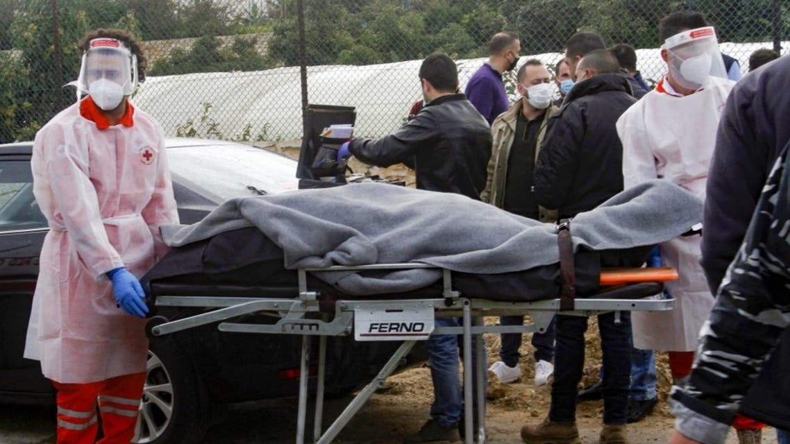 Medics evacuate the body of prominent Lebanese activist and intellectual Lokman Slim from the spot where he was found dead in his car near southern Lebanese city of Saida, on February 4, 2021. (AFP)
