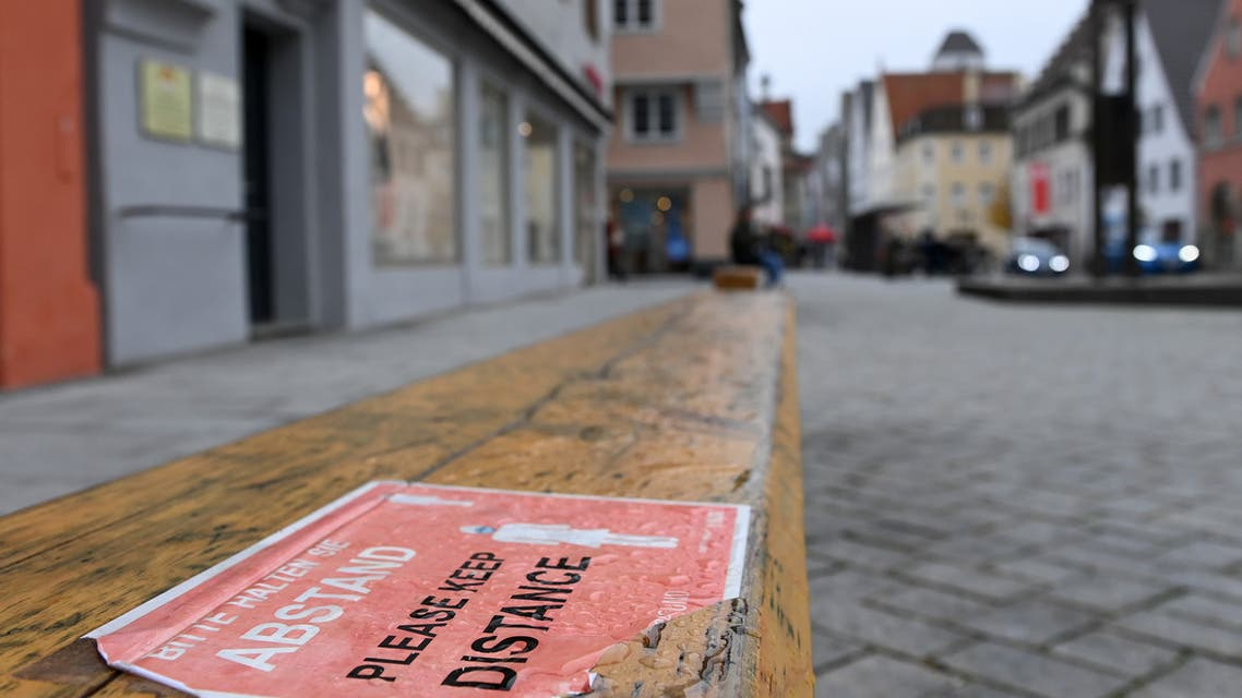 A distance sign is fixed at a bench in the city of Memmingen, southern Germany. (AFP)
