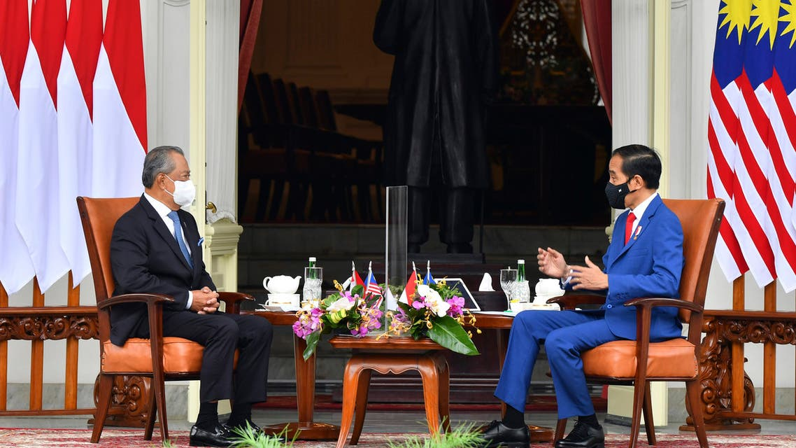 In this photo released by Indonesian Presidential Palace, Malaysian Prime Minister Muhyiddin Yassin, left, talks with Indonesian President Joko Widodo during their meeting at Merdeka Palace in Jakarta, Indonesia, Friday, Feb. 5, 2021. (AP)