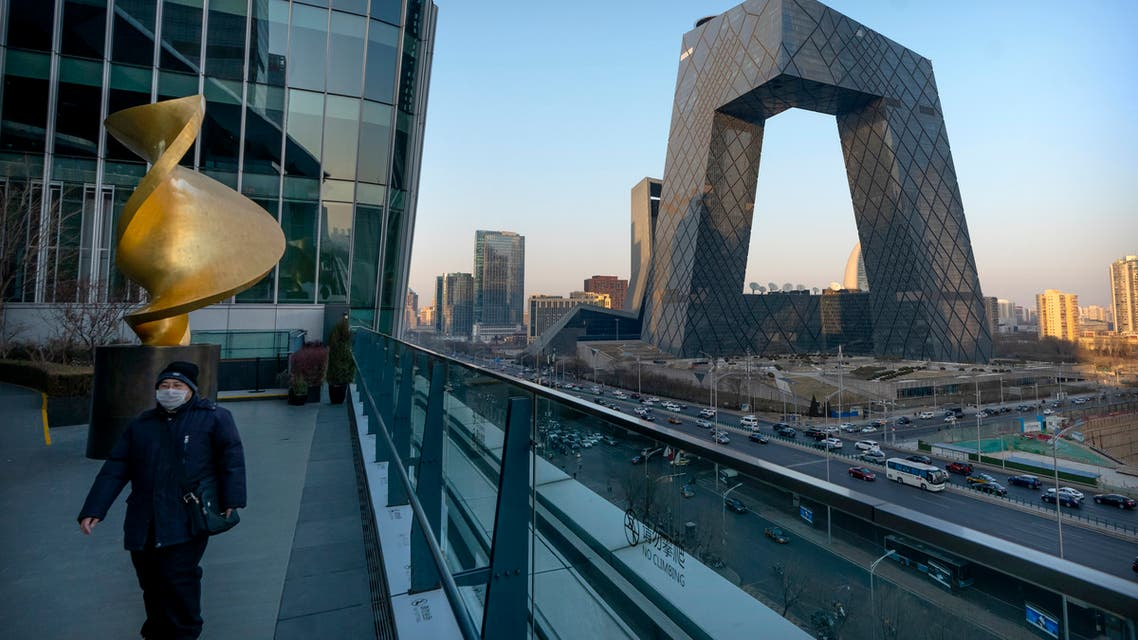 People walk past the CCTV Headquarters building, the home of Chinese state-run television network CCTV and its overseas arm CGTN, in Beijing. (File photo: AP)