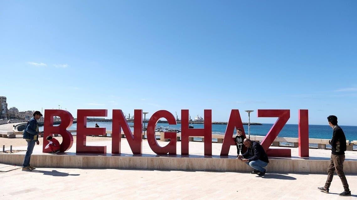 Libyan men with children are seen in front of the seaside in Benghazi, Libya Feb. 5, 2021. (Reuters)