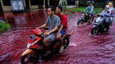 Indonesia hit with blood-red river as floods hit batik factory
