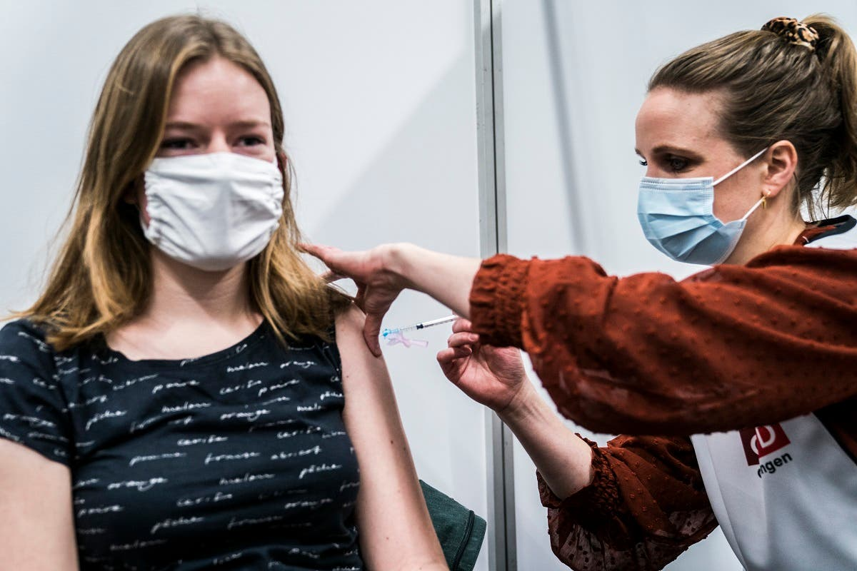 A medic receives a dose of a COVID-19 vaccine at the MartiniPlaza in Groningen, Netherlands, on January 15, 2021. (Siese Veenstra/ANP/AFP)